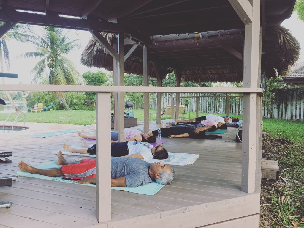 If you have a tiki hut, why not use it to host a weekly family yoga session? That's what they did!